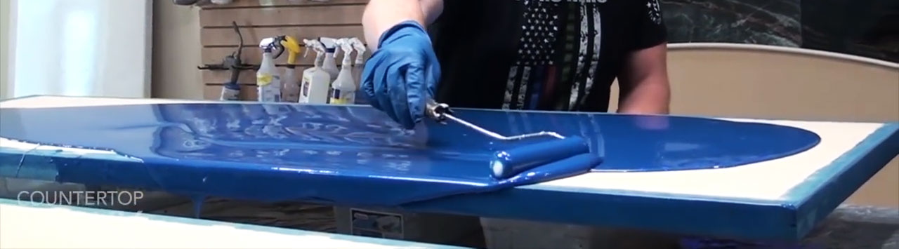 Epoxy flowing over edge in an even sheet.
